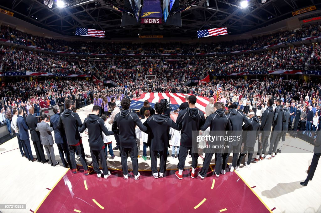 Both Cleveland Cavaliers and Orlando Magic stand while the U.S. flag is honored during the national anthem before the game on January 18, 2018 at Quicken Loans Arena in Cleveland, Ohio.