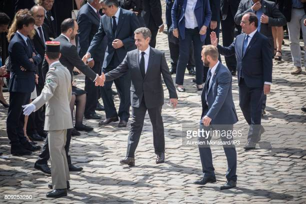 Both Former French Presidents Francois Hollande and Nicolas Sarkozy who shakes hands with French Prime Minister Edouard Philippe attend the Simone...