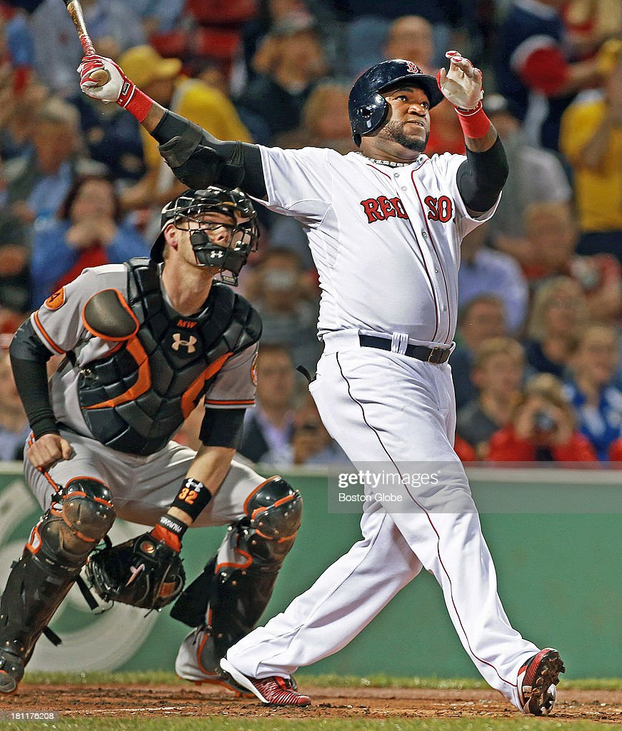Both Orioles catcher Matt Weiters and Red Sox designated hitter David Ortiz watch the launch of Ortiz' first inning two run home run. The Boston Red Sox hosted the Baltimore Orioles in an MLB regular season game at Fenway Park.