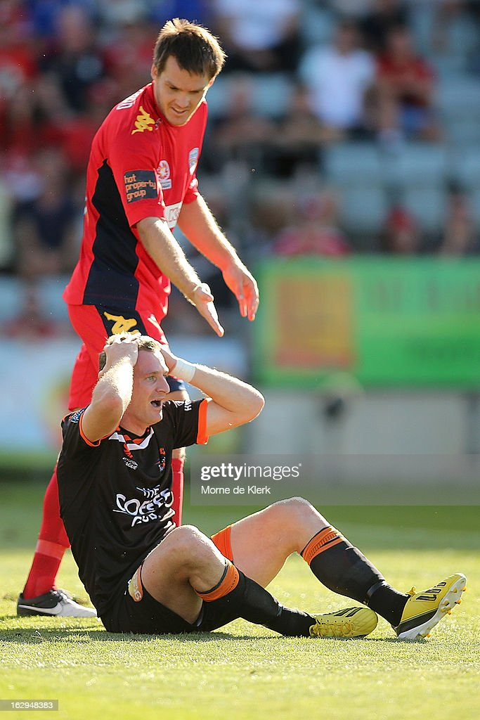 Both players react after <a gi-track='captionPersonalityLinkClicked' href=/galleries/search?phrase=Besart+Berisha&family=editorial&specificpeople=737057 ng-click='$event.stopPropagation()'>Besart Berisha</a> of Brisbane was brought down by Nigel Boogaard of Adelaide during the round 23 A-League match between Adelaide United and the Brisbane Roar at Hindmarsh Stadium on March 2, 2013 in Adelaide, Australia.