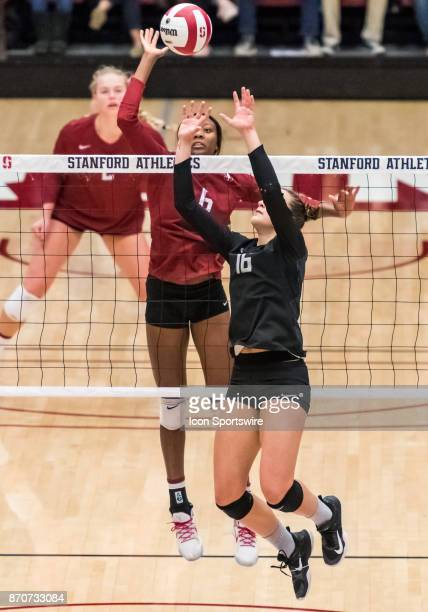 Both Stanford middle blocker Tami Alade and Oregon setter August Raskie go up for a ball near the net during the regular season game between the...