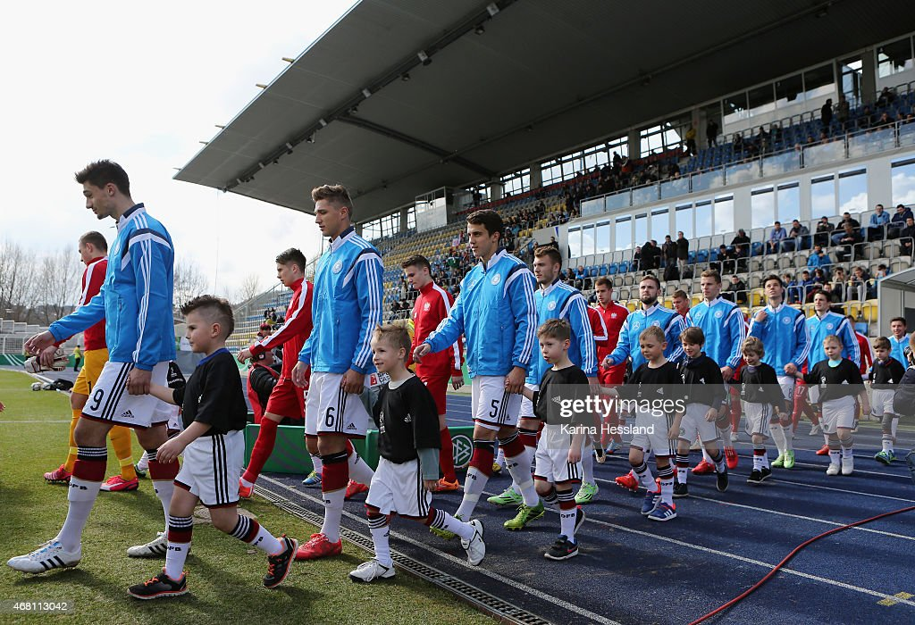 Both teams come into the stadium during the International Friendly match between U20 Germany and U20 Poland at ErnstAbbeSportfeld on March 27 2015 in...
