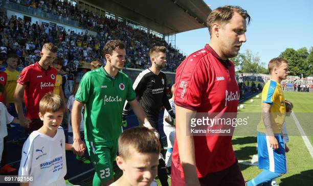 Both teams come into the stadium during the Third League Playoff Leg Two between FC Carl Zeiss Jena and Viktoria Koeln on June 01 2017 at...