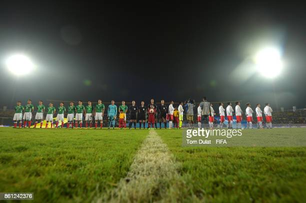 Both teams line up for their national anthems during the FIFA U17 World Cup India 2017 group E match between Mexico and Chile at Indira Gandhi...