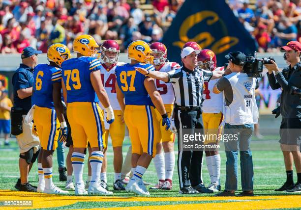 Both teams meet for the coin toss at midfield before the regular season PAC12 game between the California Golden Bears and the USC Trojans on...
