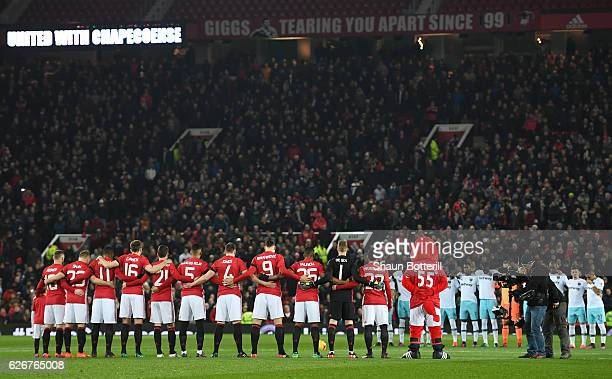 Both teams observe a minutes silence ahead of the EFL Cup quarter final match between Manchester United and West Ham United at Old Trafford on...