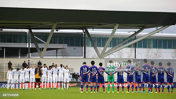 Both teams observe a minutes silence in memory of those who died in the Paris terrorist attack prior to the U19 International friendly match between...