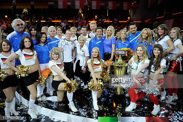 Both teams pose after the end of the 'Deutschland Gegen Italien' TV Show on April 20 2011 in Duesseldorf Germany