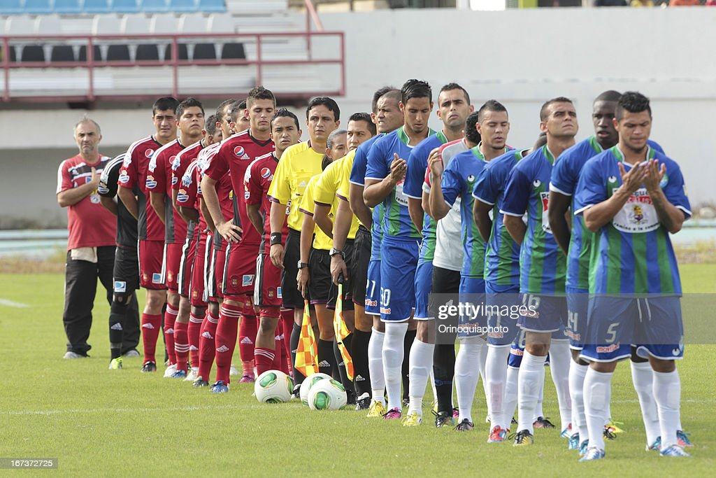 Both teams sing the national anthem of Venezuela before a match between Llaneros de Guanare and Caracas FC as part of the Clausura Tournament 2013 at the Estadio Olimpico Rafael Calles Pinto on April 24, 2013 in Guanare, Venezuela.
