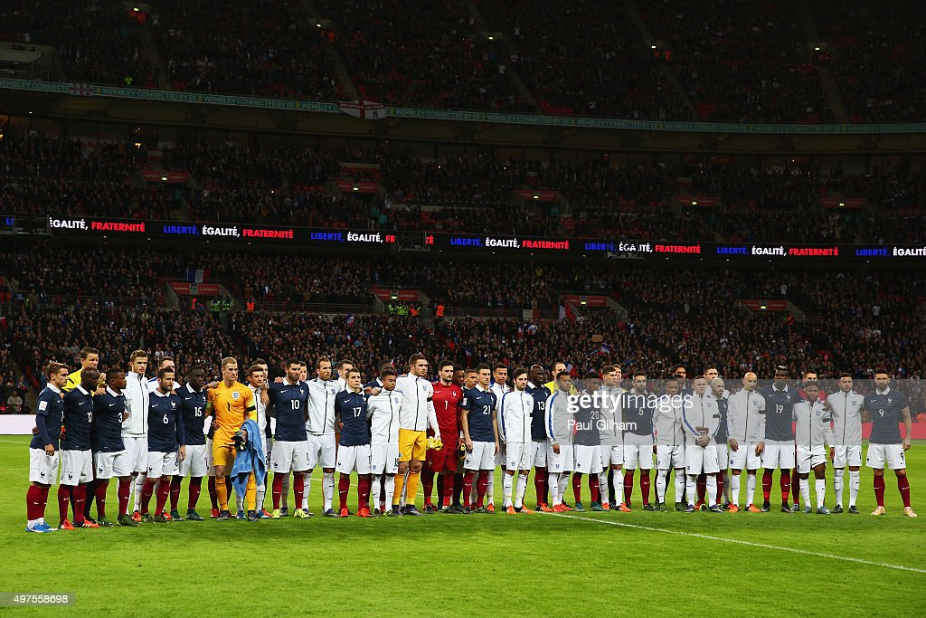 Both teams stand together for a moment of applause prior to the International Friendly match between England and France at Wembley Stadium on...