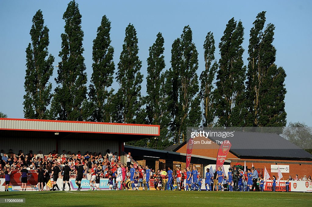 Both teams walk out the tunnel during the FA WSL match between Arsenal Ladies FC and Chelsea Ladies FC at Meadow Park on June 06, 2013 in Borehamwood, England.