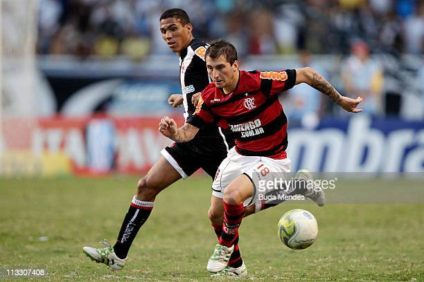 Botinelli of Flamengo struggles for the ball with Allan of Vasco during a match as part of Rio de Janeiro State Championship 2011 at Engenhao stadium...