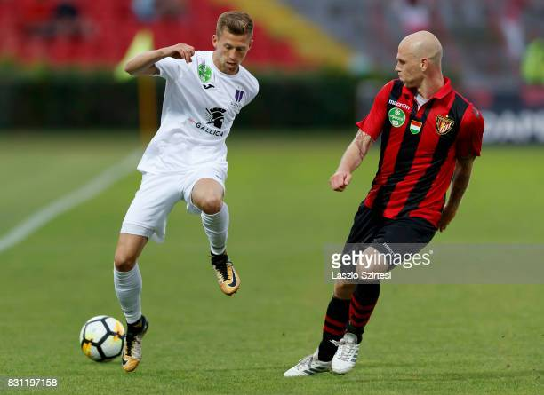 Botond Barath of Budapest Honved competes for the ball with Krisztian Simon of Ujpest FC during the Hungarian OTP Bank Liga match between Budapest...
