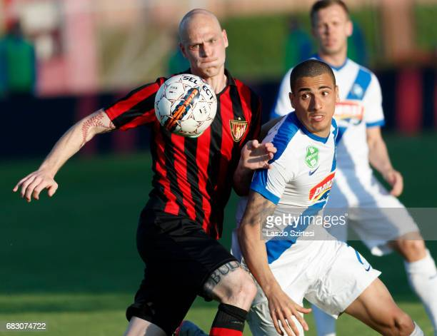 Botond Barath of Budapest Honved duels for the ball with Myke Bouard Ramos of MTK Budapest during the Hungarian OTP Bank Liga match between Budapest...