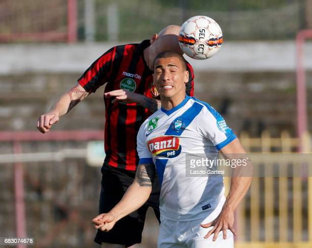 Botond Barath of Budapest Honved wins the ball in the air from Myke Bouard Ramos of MTK Budapest during the Hungarian OTP Bank Liga match between...