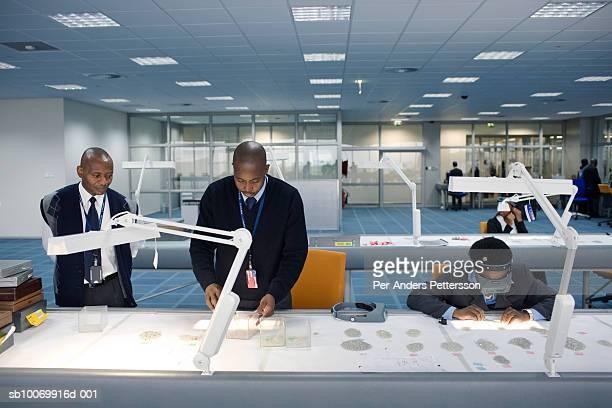 Botswana, Gaborone, workers sorting diamonds
