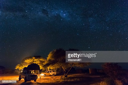 Botswana, Kalahari, Central Kalahari Game Reserve, campsite with campfire under starry sky