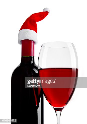 Bottle and glass of red wine with santa hat : Stock Photo