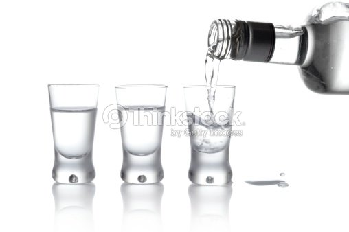 Bottle and glasses vodka poured into glass isolated on for Alcohol bottles made into glasses
