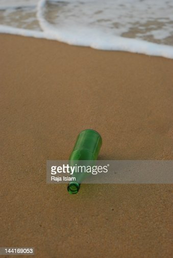 Bottle at beach : Stock Photo