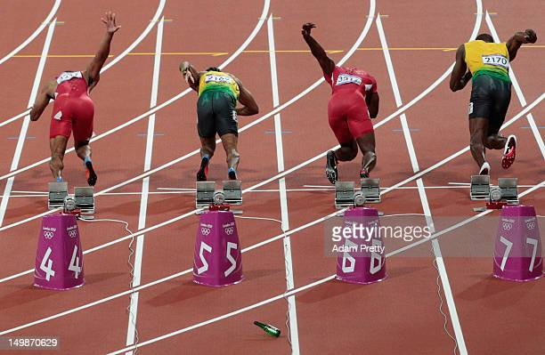 A bottle is thrown onto the track at the start of the Men's 100m Final on Day 9 of the London 2012 Olympic Games at the Olympic Stadium on August 5...