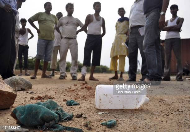 Bottle of acid and burnt clothes of the acidattack victim lying near the incident spot at CrossingsRepublik area of Ghaziabad on July 26 2013 in...