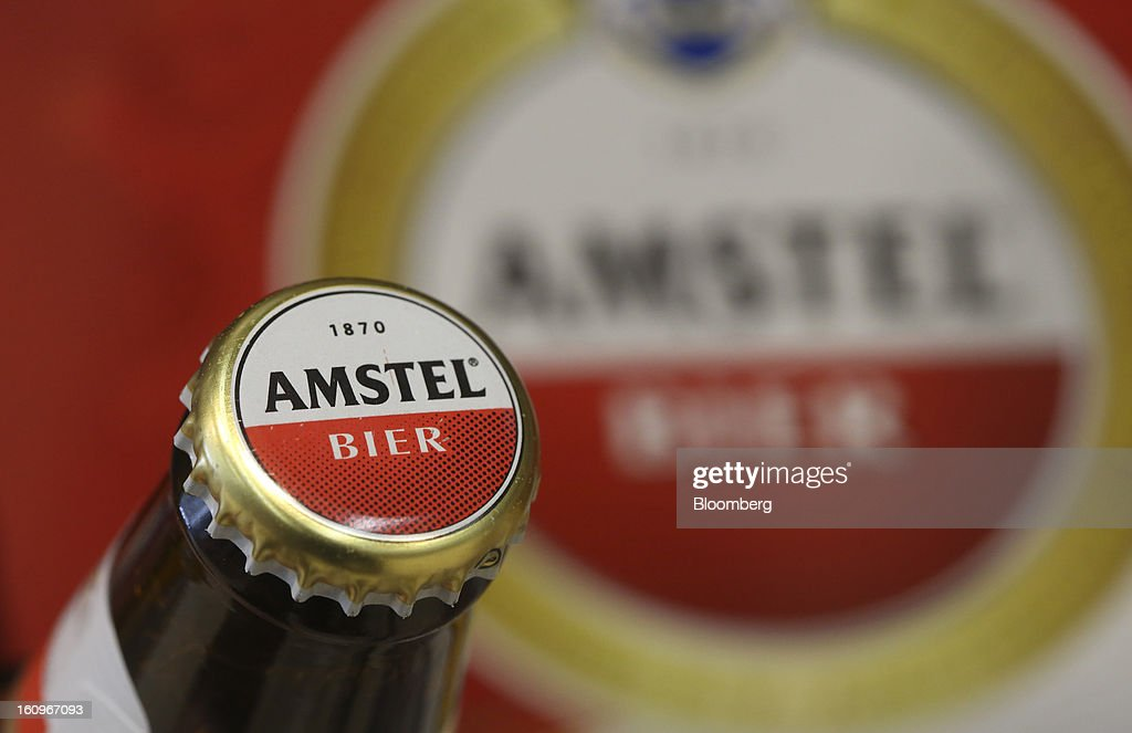 A bottle of Amstel lager beer, produced by Heineken NV, sits on display inside a supermarket in London, U.K., on Friday, Feb. 8, 2013. Britain's economy will grow more slowly this year than previously forecast and stagnation may persist, according to the National Institute of Economic and Social Research. Photographer: Chris Ratcliffe/Bloomberg via Getty Images