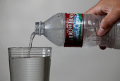 A bottle of Arrowhead water is poured into a glass on August 20 2014 in San Anselmo California Despite the historic California drought that has left...