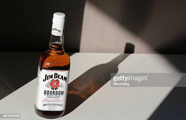A bottle of Beam Inc's Jim Beam bourbon whiskey is arranged for a photograph in Tokyo Japan on Tuesday Jan 14 2014 Suntory Holdings Ltd the closely...