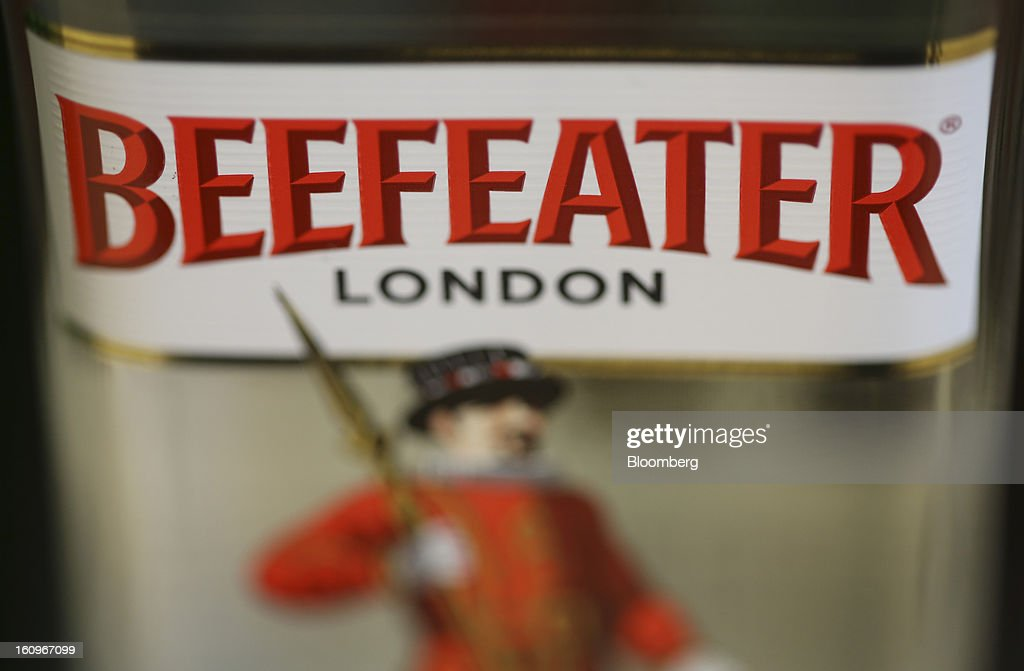 A bottle of Beefeater London gin, produced by Pernod Ricard SA, sits on display inside a supermarket in London, U.K., on Friday, Feb. 8, 2013. Britain's economy will grow more slowly this year than previously forecast and stagnation may persist, according to the National Institute of Economic and Social Research. Photographer: Chris Ratcliffe/Bloomberg via Getty Images