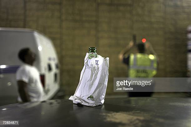 A bottle of beer sits on the roof of a car at a DUI checkpoint December 15 2006 in Miami Florida The city of Miami with the help of other police...