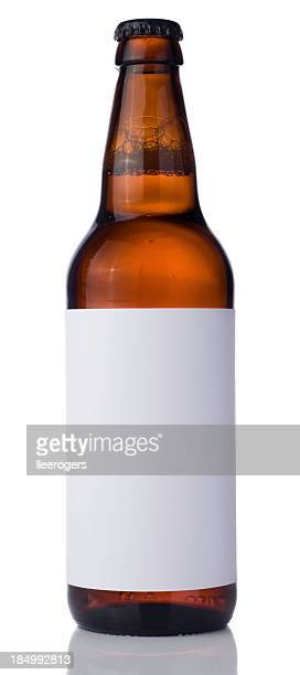 Bottle of beer with blank label on a white background