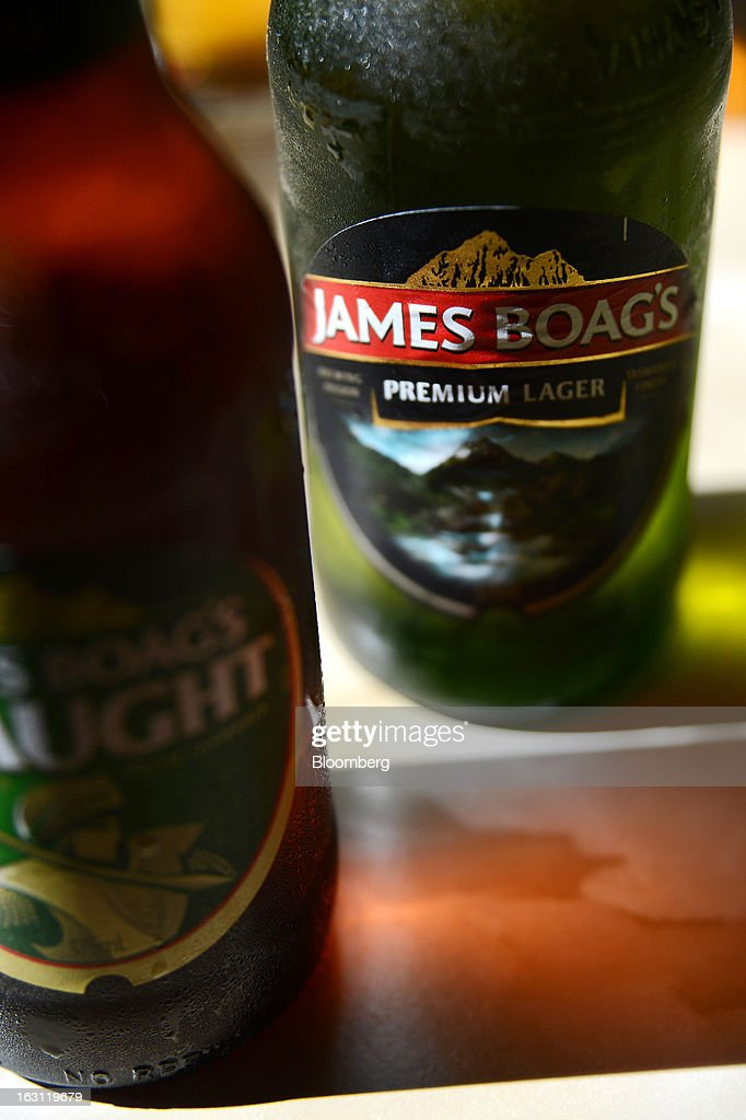 A bottle of Boag's Draught beer, left, and a bottle of James Boag's Premium Lager are arranged for a photograph at the Boag's brewery, operated by Kirin Holdings Co.'s Lion unit, in Launceston, Tasmania, Australia, on Monday, Feb. 25, 2013. Australia's Bureau of Statistics is scheduled to release fourth-quarter gross domestic product figures on March 6. Photographer: Carla Gottgens/Bloomberg via Getty Images