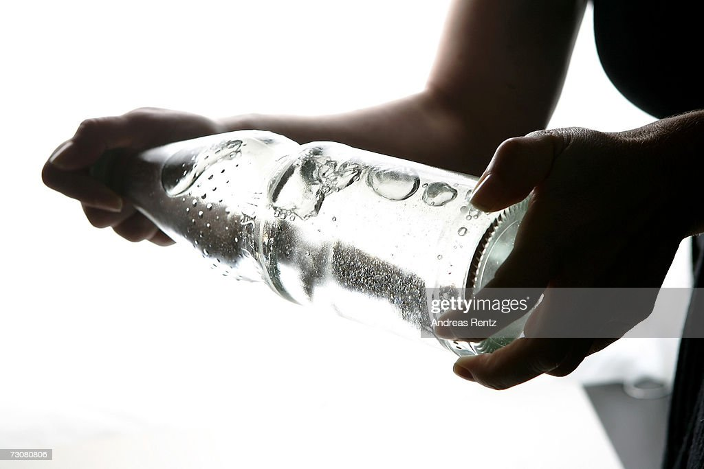 A bottle of carbonated mineral water is being shaken on January 14, 2007 in Berlin, Germany.