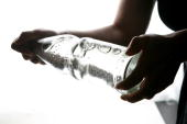 A bottle of carbonated mineral water is being shaken on January 14 2007 in Berlin Germany
