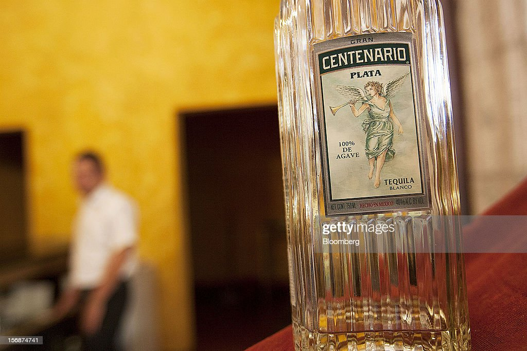 A bottle of Centenario silver tequila is arranged for a photograph on a bar at the Tequila Cuervo La Rojena S.A. de C.V., maker of Jose Cuervo, distillery plant in Guadalajara, Mexico, on Thursday, Nov. 22 2012. There are more than 200 types of agave in Mexico, but use of the blue agave plant was made compulsory in the last century to the issuance of the Official Mexican Standard for Tequila production. Photographer: Susana Gonzalez/Bloomberg via Getty Images