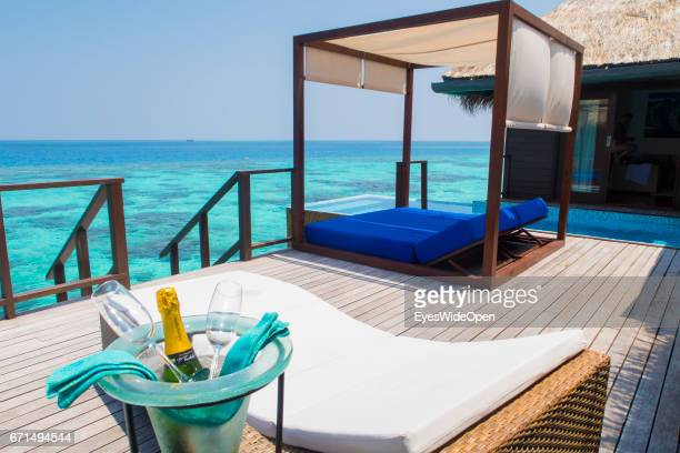 Bottle of Champagne and Sunbeds at the Terrace Deck of a Water Villa at Coco Bodu Hiti NorthMaleAtoll on February 23 2017 in Male Maldives