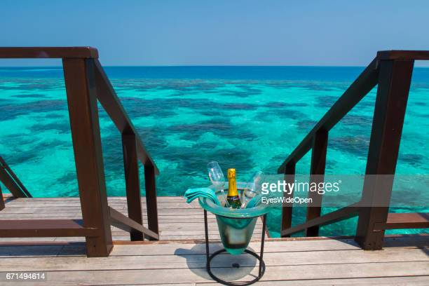 Bottle of Champagne at the Terrace Deck of a Water Villa at Coco Bodu Hiti NorthMaleAtoll on February 23 2017 in Male Maldives