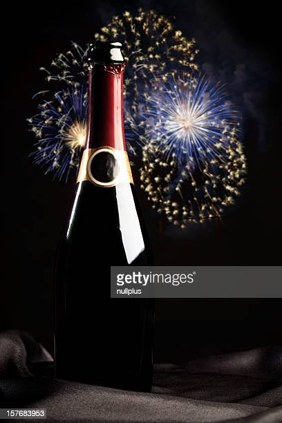 bottle of champagne with fireworks in the background