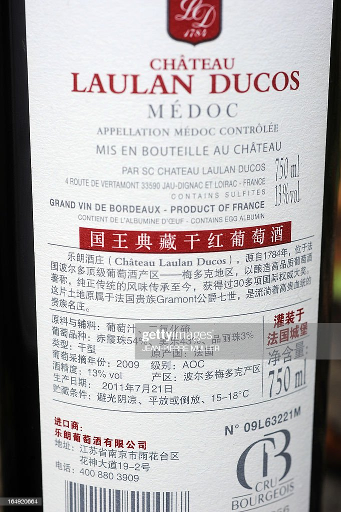 A bottle of Chateau Laulan-Ducos, a cru bourgeois wine of Bordeaux's Medoc region, owned by Chinese jewelry chain TESiRO's head Richard Shen (Shen Dongjun), is pictured on March 29, 2013 in Jau-Dignac-et-Loirac.
