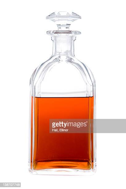 Bottle of cognac against white background, close-up