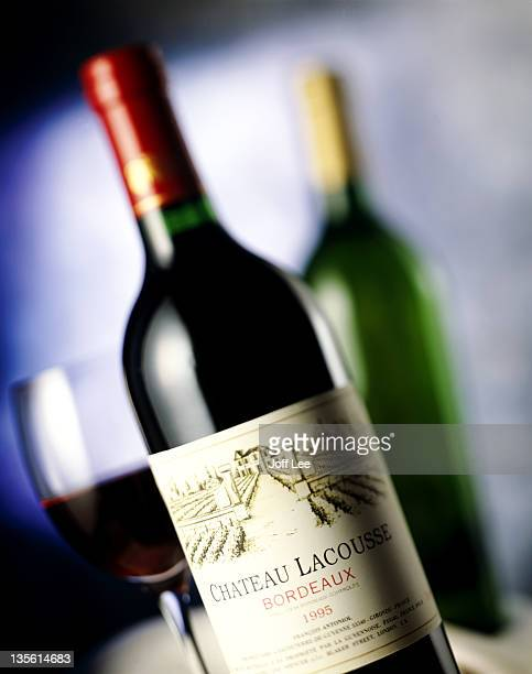 Bottle of French wine with glass, bottle behind
