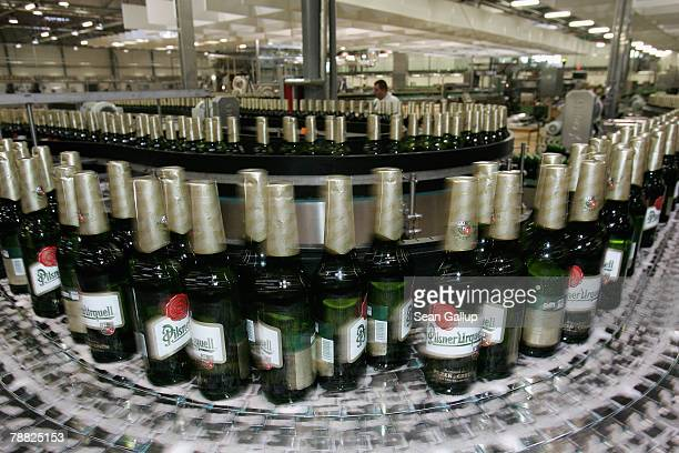 Bottle of freshlybrewed PilsnerUrquell lager beer run through the newlybuilt ultramodern bottling plant at the Prazdroj brewery November 15 2006 in...