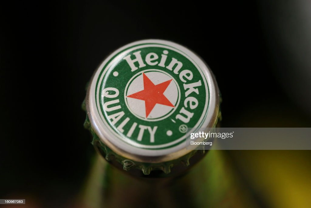 A bottle of Heineken lager beer, produced by Heineken NV, sits on display inside a supermarket in London, U.K., on Friday, Feb. 8, 2013. Britain's economy will grow more slowly this year than previously forecast and stagnation may persist, according to the National Institute of Economic and Social Research. Photographer: Chris Ratcliffe/Bloomberg via Getty Images