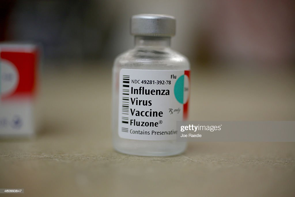 A bottle of influenza vaccine is seen in the MinuteClinic at the CVS/pharmacy on January 6 2014 in Fort Lauderdale Florida The 20132014 influenza...