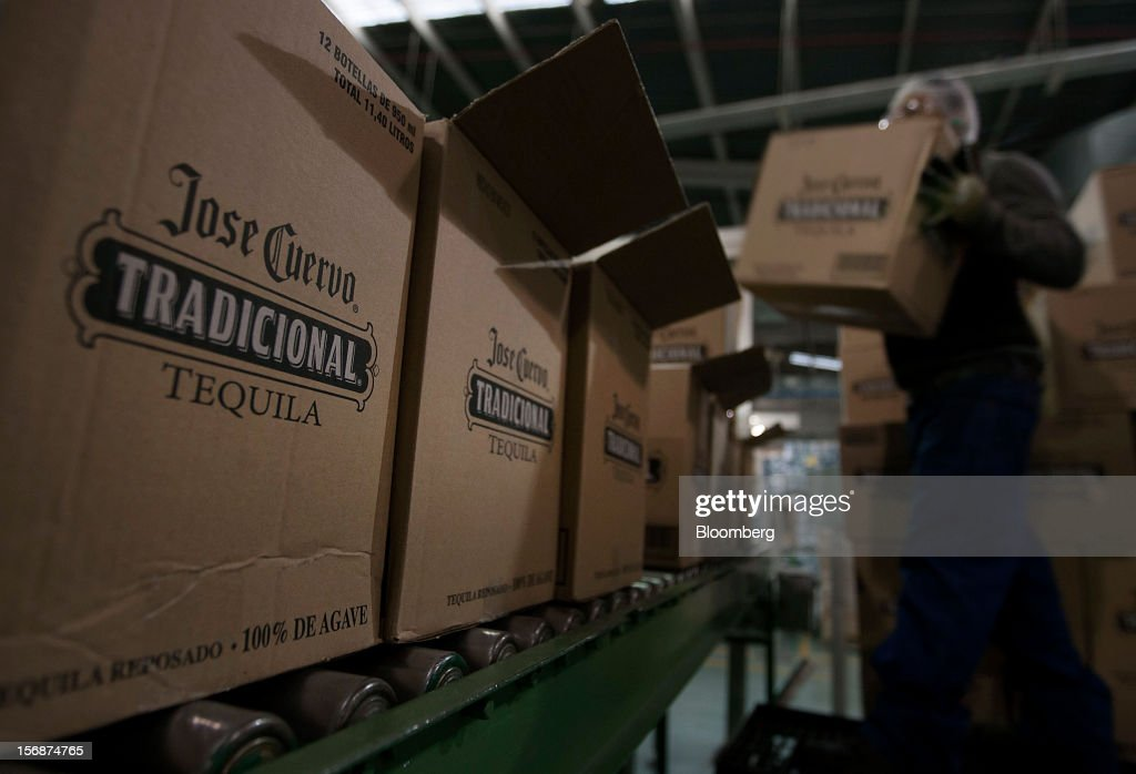 Bottle of Jose Cuervo Tradicional are boxed for shipment at the Tequila Cuervo La Rojena S.A. de C.V. bottling factory in Guadalajara, Mexico, on Thursday, Nov. 22 2012. There are more than 200 types of agave in Mexico, but use of the blue agave plant was made compulsory in the last century to the issuance of the Official Mexican Standard for Tequila production. Photographer: Susana Gonzalez/Bloomberg via Getty Images