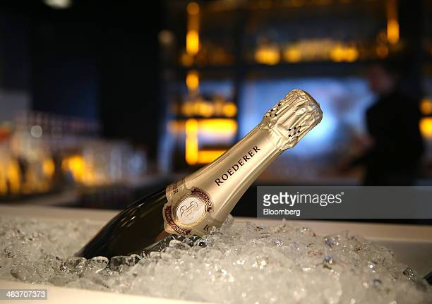 A bottle of Louis Roederer champagne sits on ice in the 'Studio Grigio' bar at the InterContinental hotel Davos operated by InterContinental Hotels...