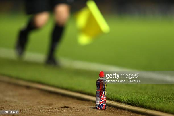 A bottle of Lucozade on the touchline