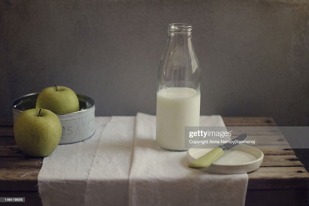 Bottle of milk and two apples