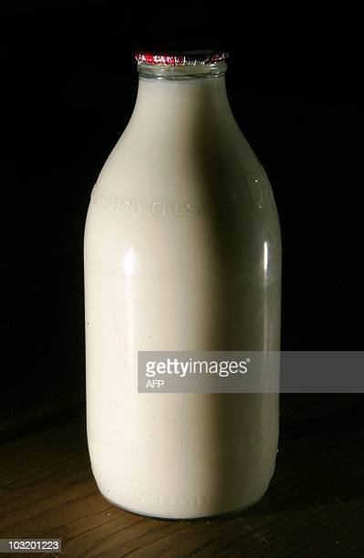 A bottle of milk is pictured on a table in London on August 2 2010 Food safety officials in Britain are to investigate a claim that milk from the...